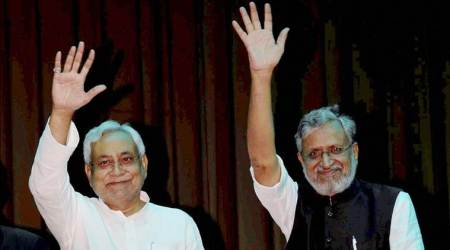 Patna: Nitish Kumar and Shushil Kumar Modi wave at gathering after they were sworn-in as Bihar Chief Minister and Dy Chief Minister respectively, at a ceremony in Patna on Thursday. PTI Photo (PTI7_27_2017_000194B)